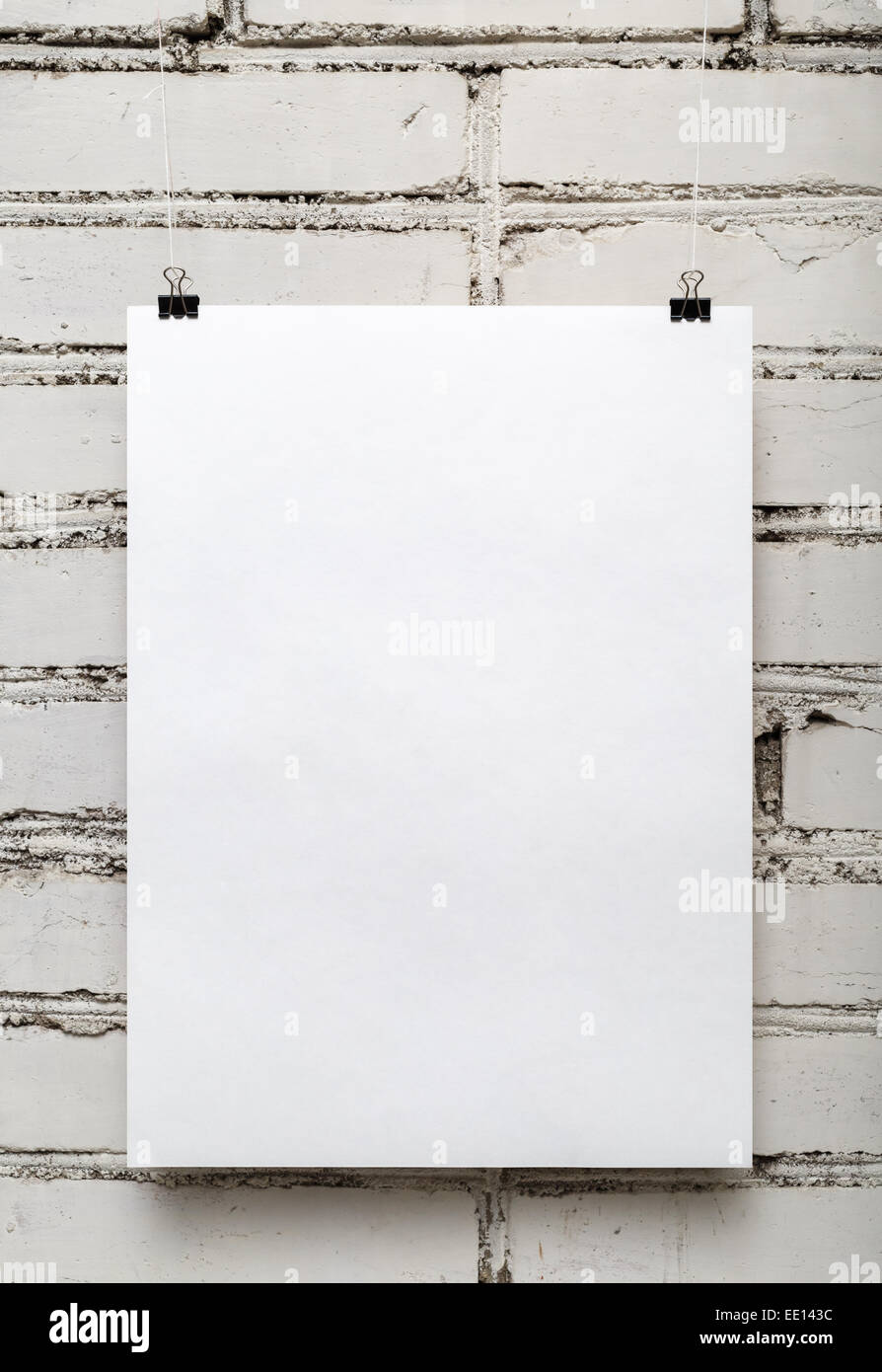 Blank White Poster Against A Brick Wall Vertical Shot