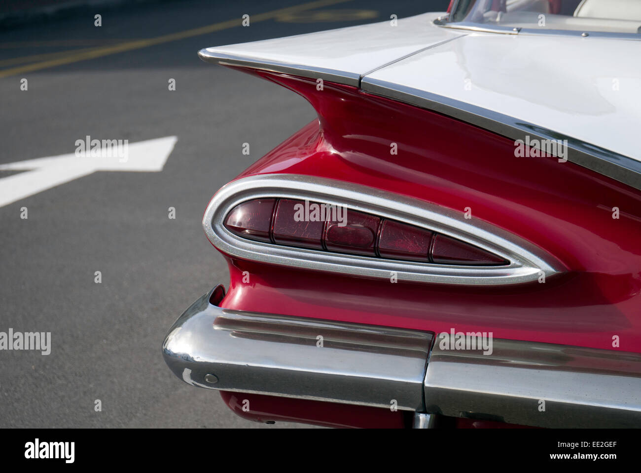 The tail of a classic 1950 s chevrolet chevy impala probably a 1959 sedan