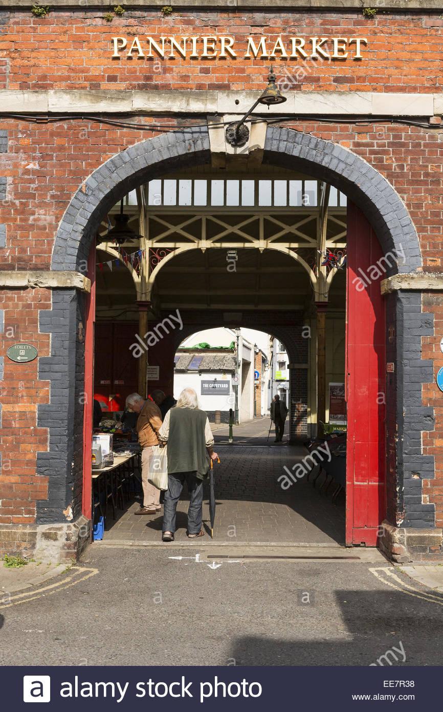Elderly man enters the Pannier Market Barnstaple Devon & Elderly man enters the Pannier Market Barnstaple Devon Stock ...