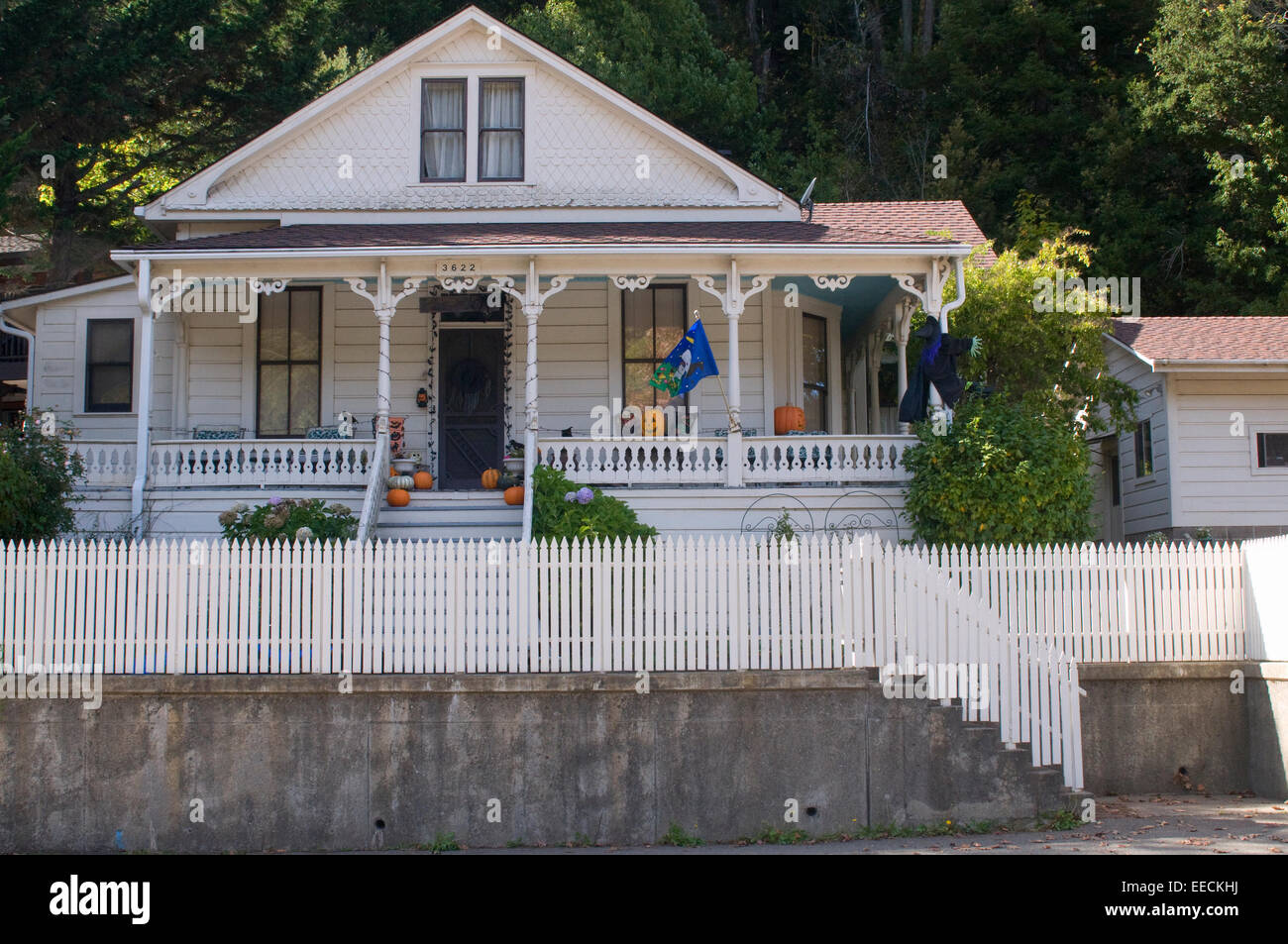 quaint wooden white picket fence house in occidental northern stock photo royalty free image. Black Bedroom Furniture Sets. Home Design Ideas