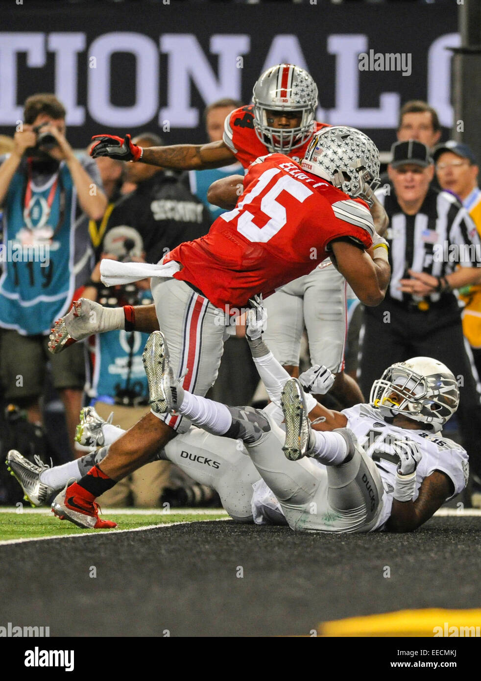 Ezekiel elliott ohio state beat oregon to win national - Ohio State Receiver Corey Smith 84 Watches As Running Back Ezekiel Elliott 15 Runs Over Oregon Defensive Backs Chris Seisay 12 And Tyree Robinson 2