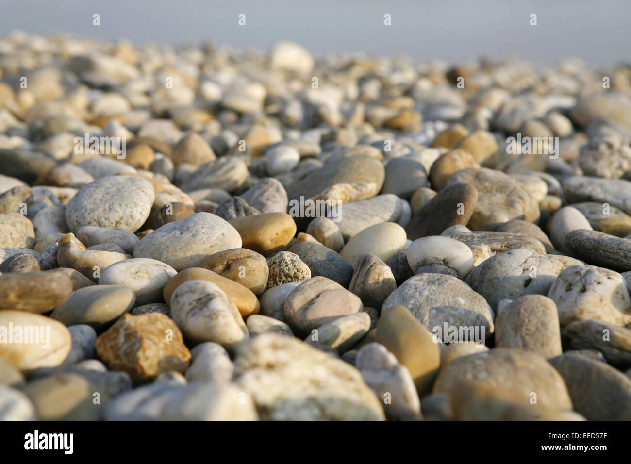 steine wasser see ufer strand dunst geologie gestein stein stock photo royalty free. Black Bedroom Furniture Sets. Home Design Ideas