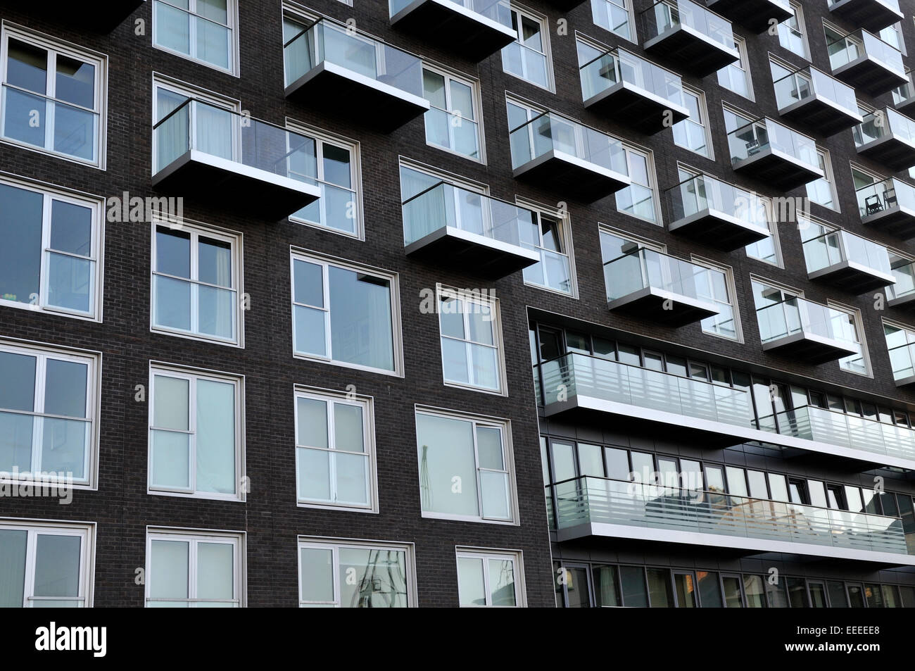 Windows And Balconies On Modern High Rise Apartment Building Stock