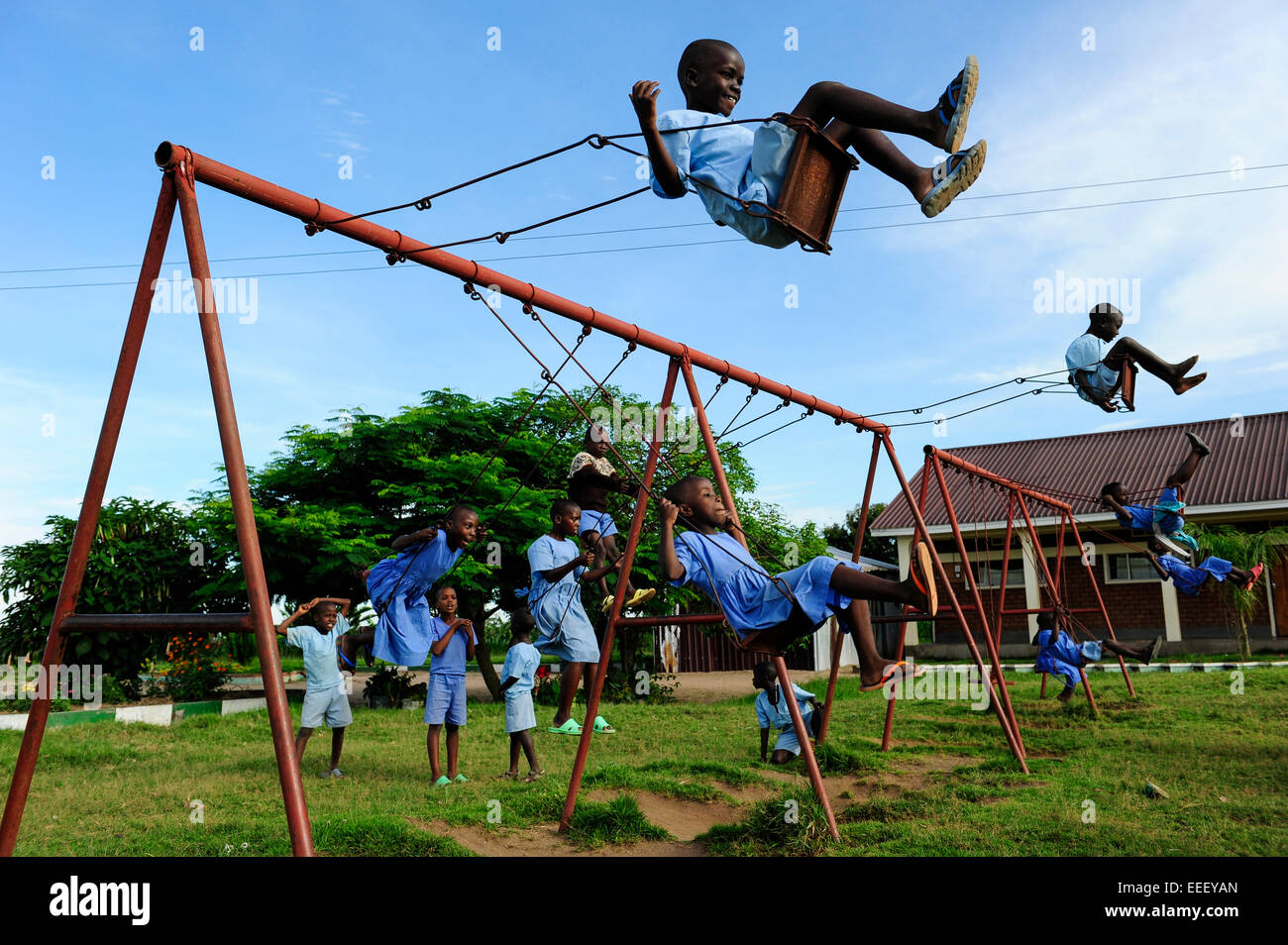 tanzania bukoba children play at swing of playground in school - Images Of Children Playing At School