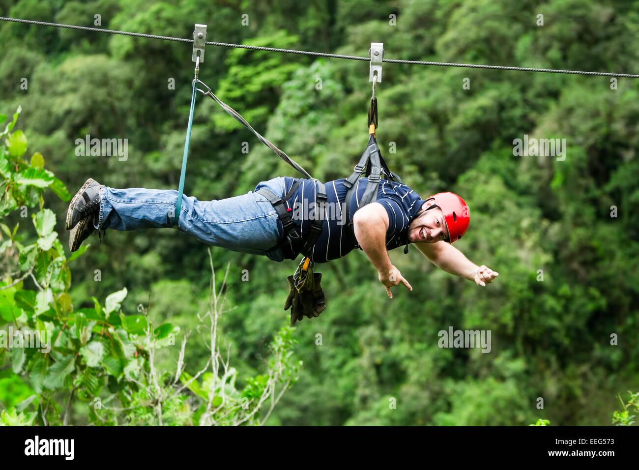 oversized adult man on zip line zip line zipline or canopy