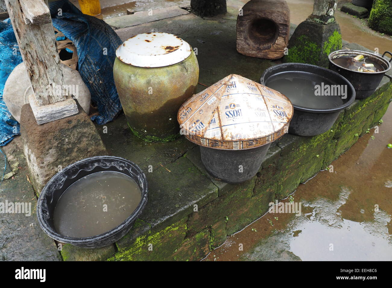 cooking pots and pots of water in a food preparation area in a cooking pots and pots of water in a food preparation area in a home in bali
