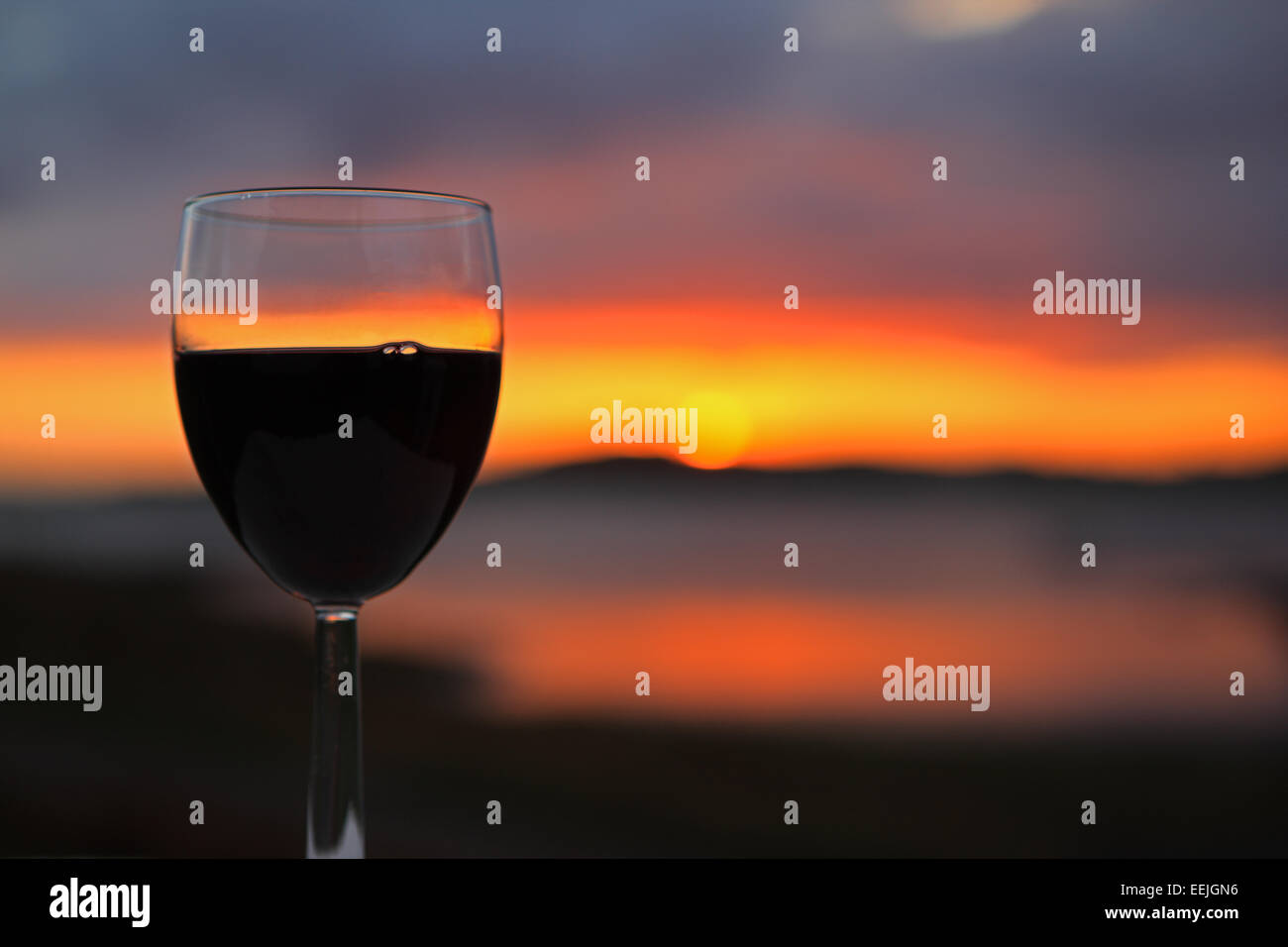 glass-of-red-wine-against-a-stunning-sun