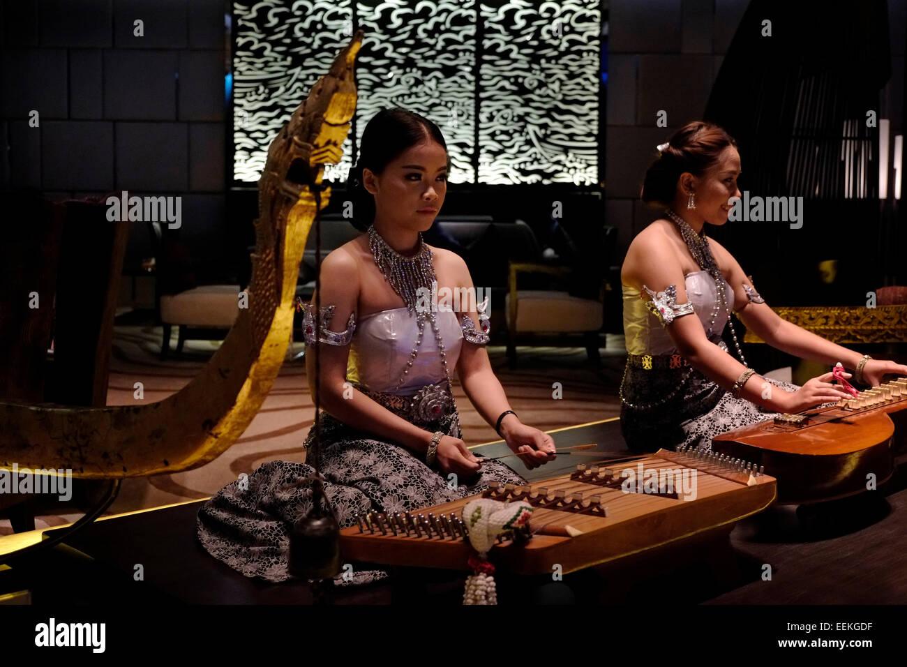 Woman playing khim, traditional Thai musical instrument. Phuket ...