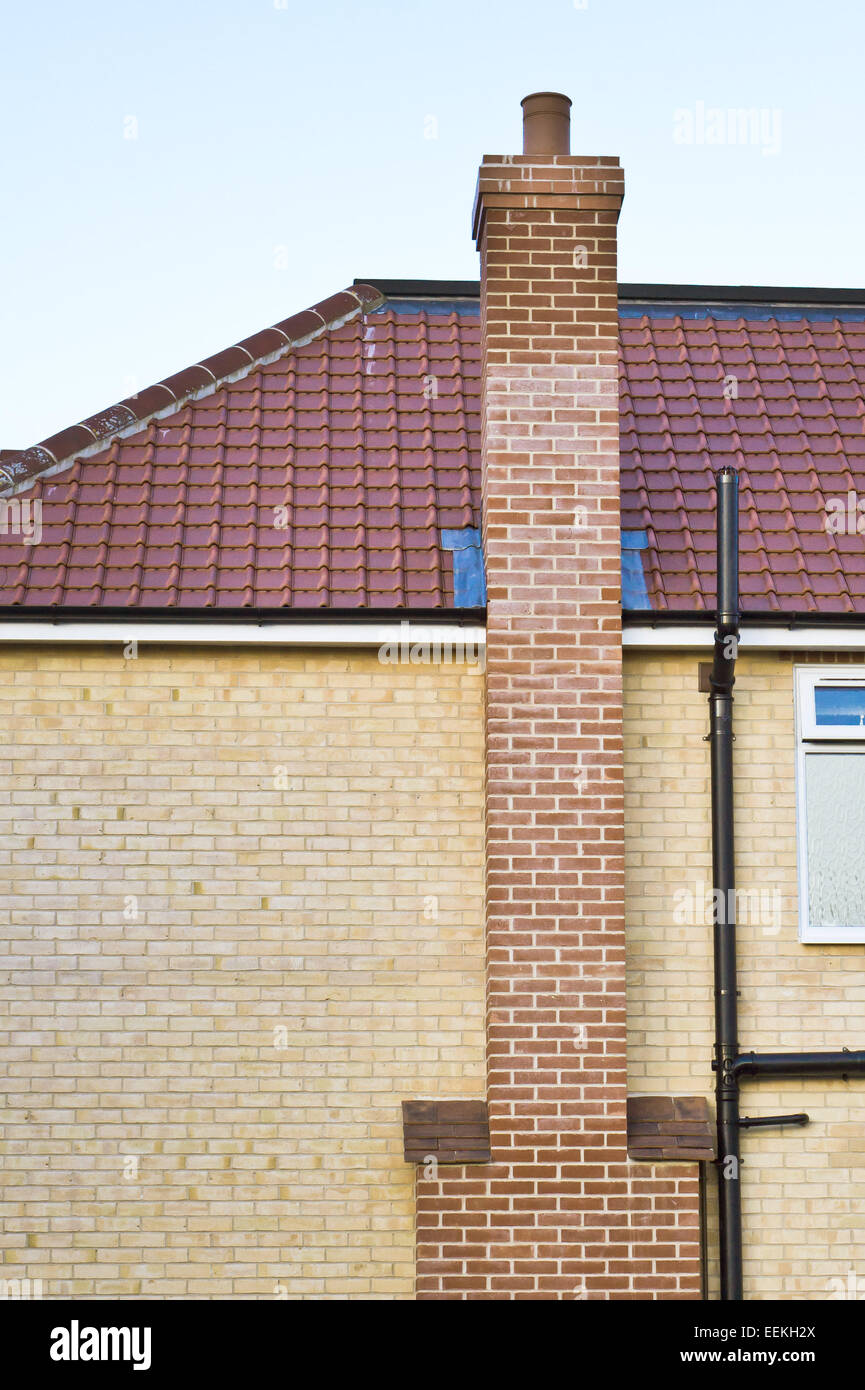 Brick House With Chimney : Modern house with a red brick chimney stack stock photo