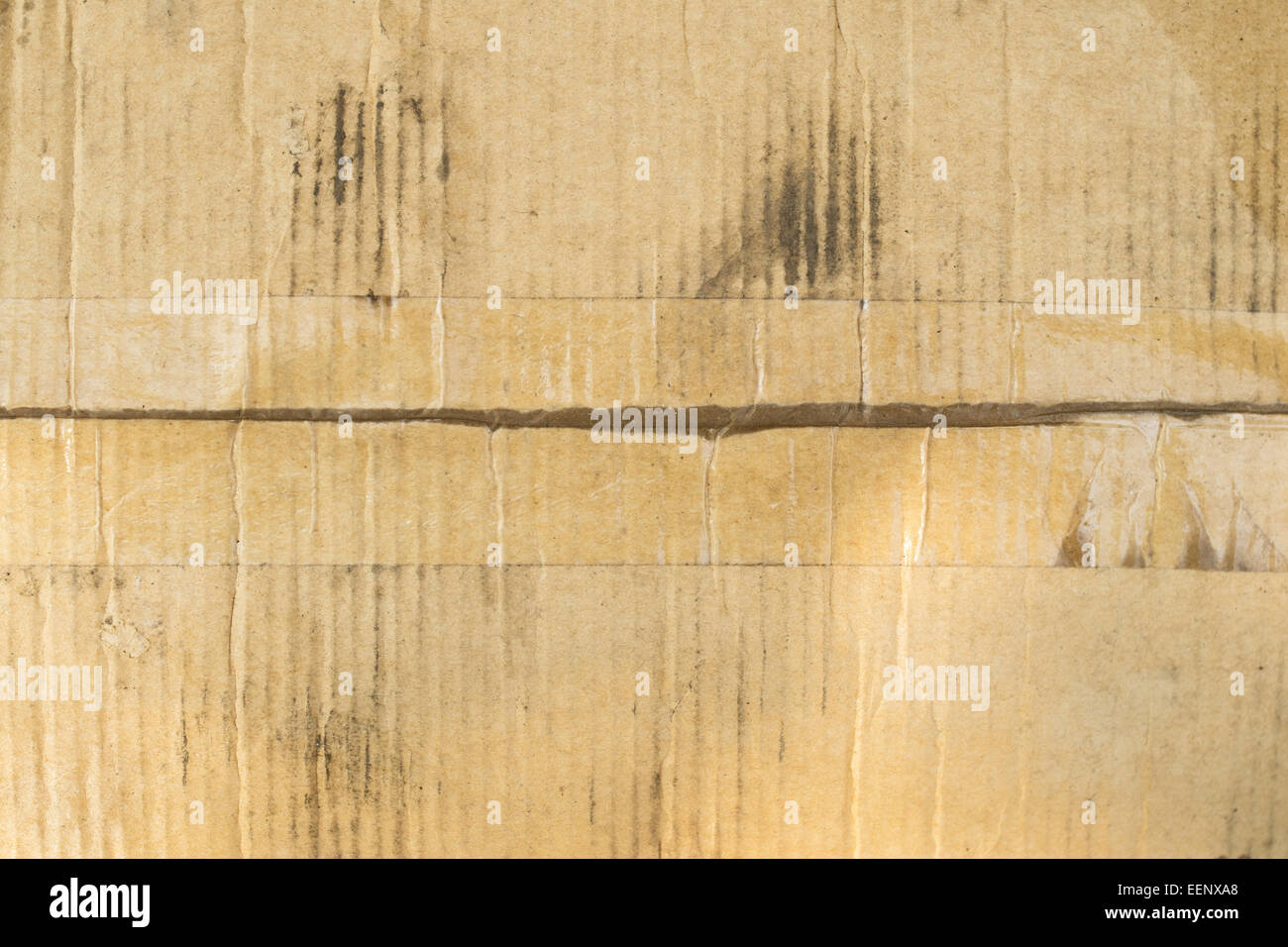 Dirty Cardboard Box With Clear Adhesive Tape Stock Photo