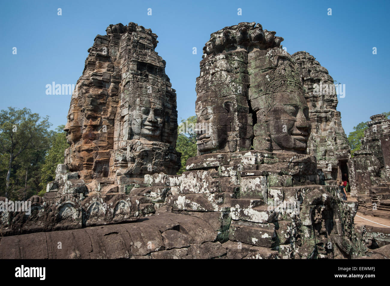 Carved stone heads of bayon temple angkor wat cambodia