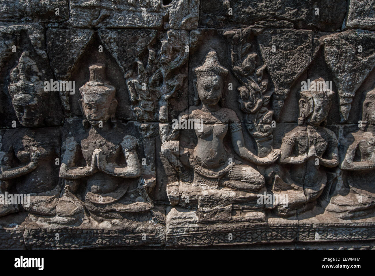 Carved stone figures on the wall at bayon temple angkor