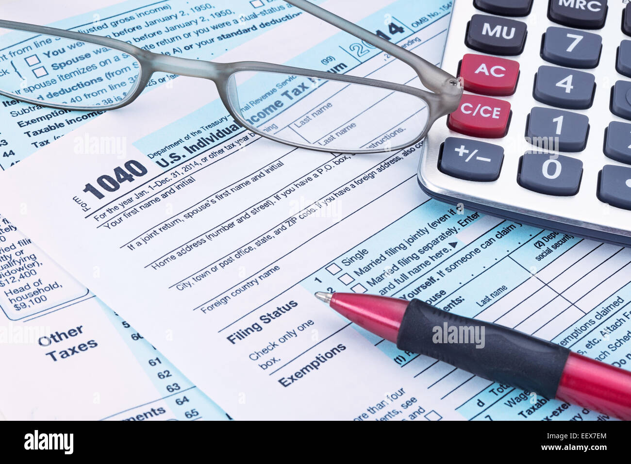 2014 irs form 1040 with calculator and pen stock photo royalty 2014 irs form 1040 with calculator and pen falaconquin