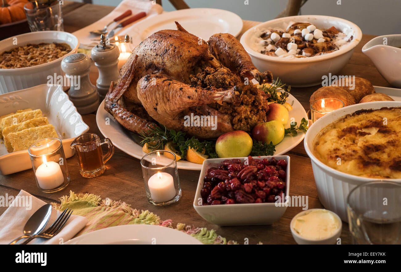 Dining Table With Food dining table filled with thanksgiving food stock photo, royalty