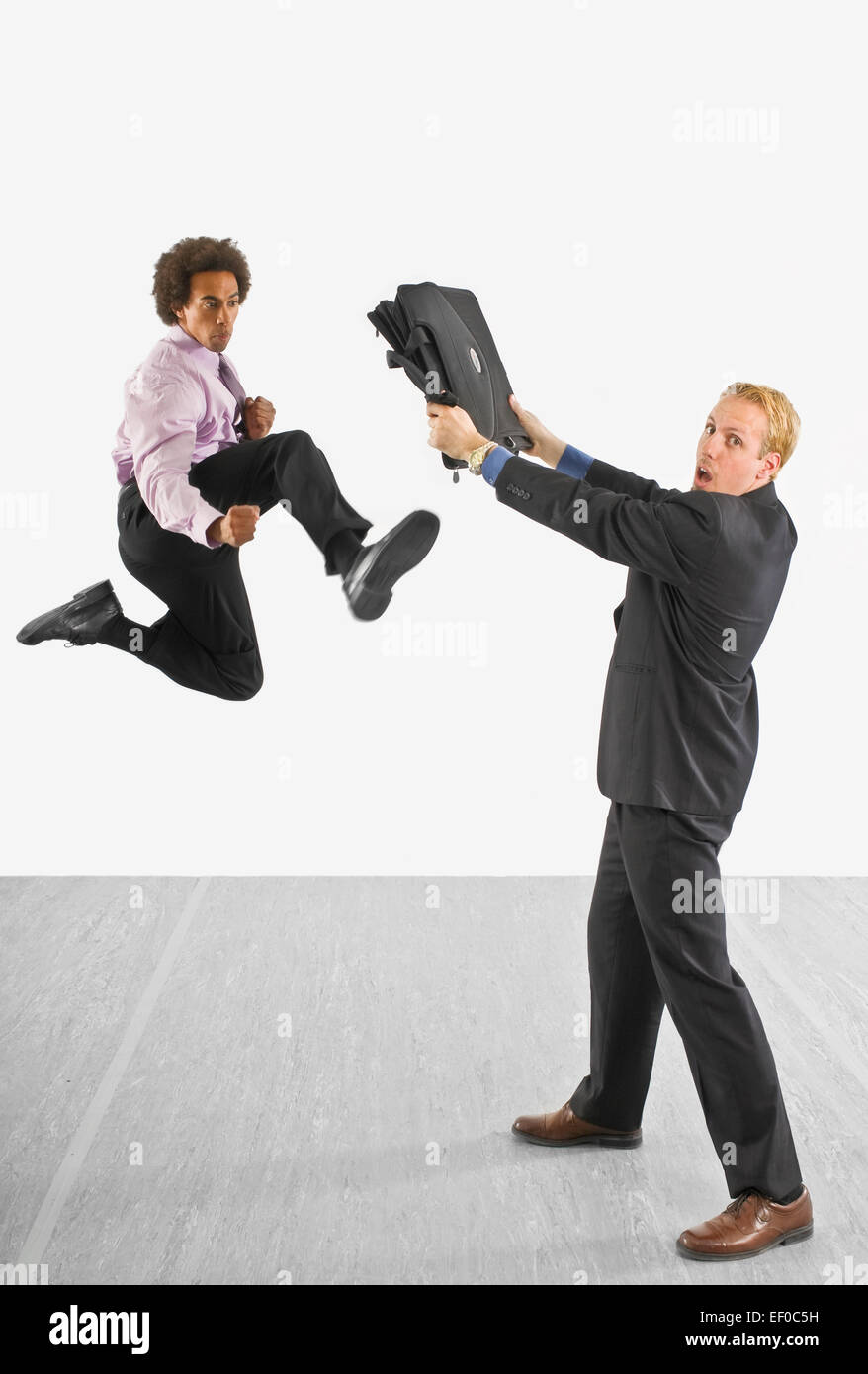 Two business people fighting Stock Photo, Royalty Free ...