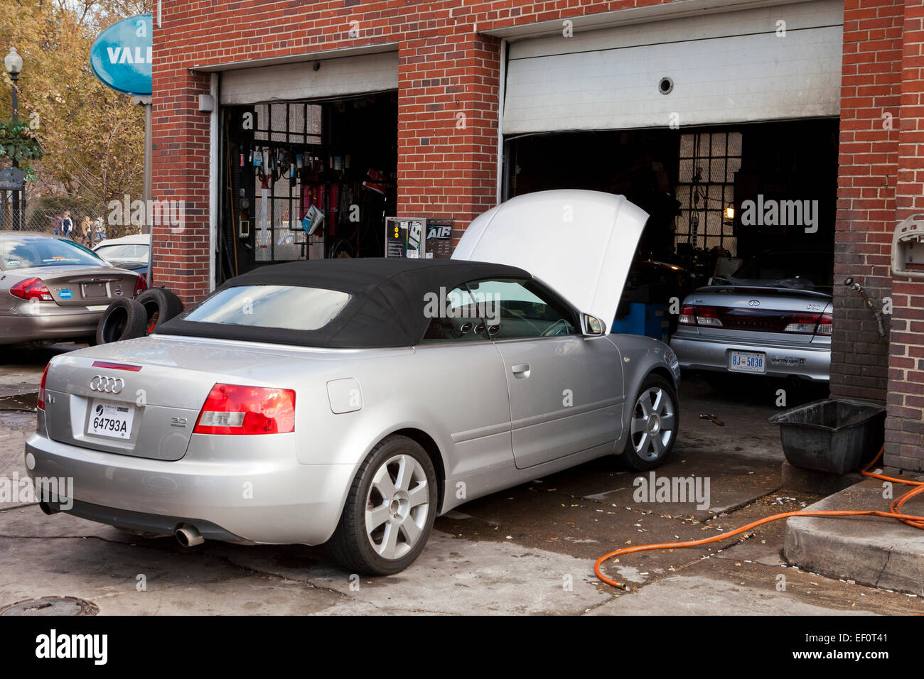 Audi A Parked In Front Of Auto Service Garage USA Stock Photo - Audi car garage