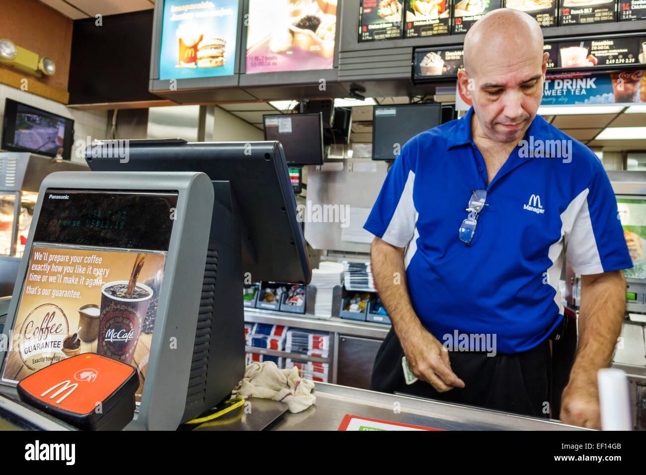 fast food employee counter stock photos fast food employee miami florida mcdonald s restaurant fast food counter man employee inside manager stock image