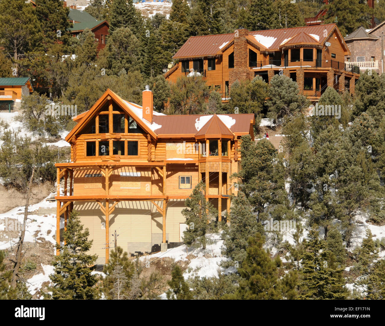 Lake Luxury Log Homes: Luxury Log Cabins On A Snowy Mountain Slope Stock Photo