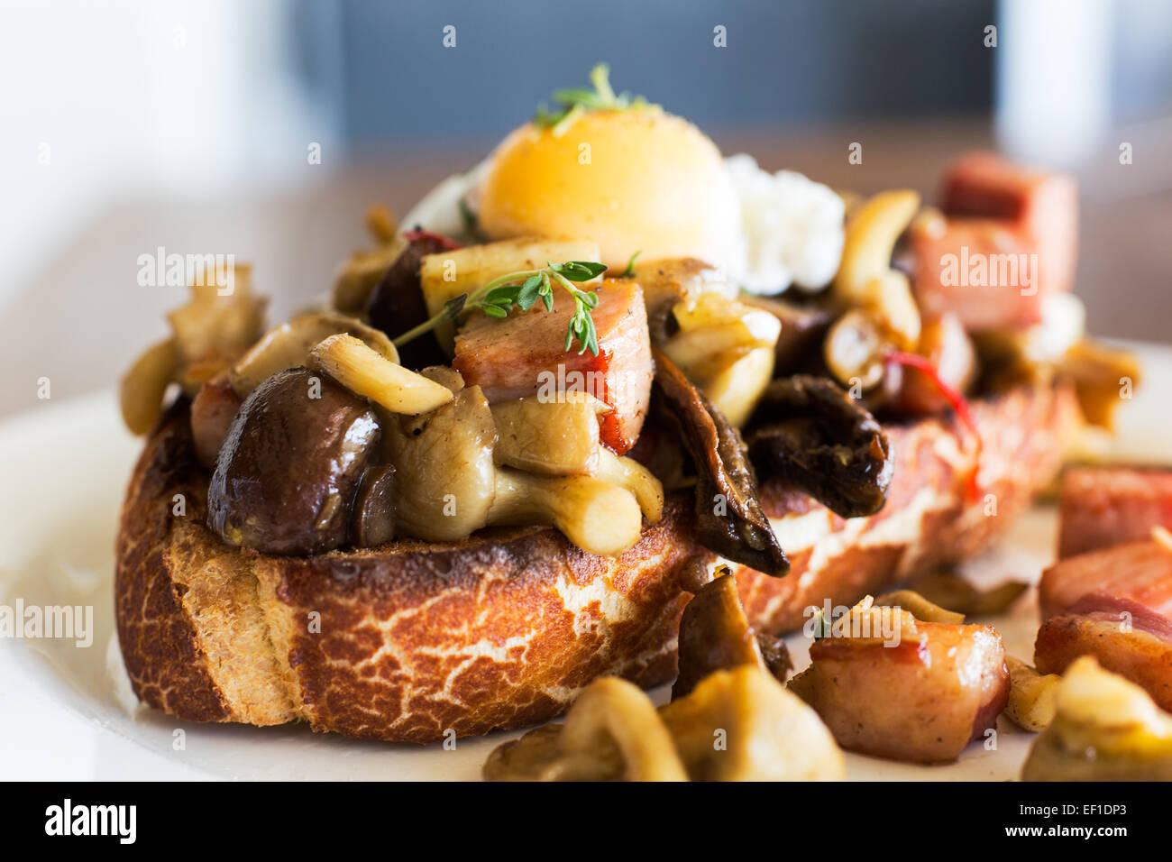 Mushrooms, Egg, bacon on toast Stock Photo, Royalty Free Image ...
