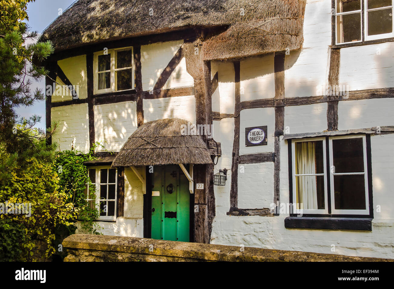 Thatched porch on the old bakery in keevil wiltshire uk for Classic house bakery