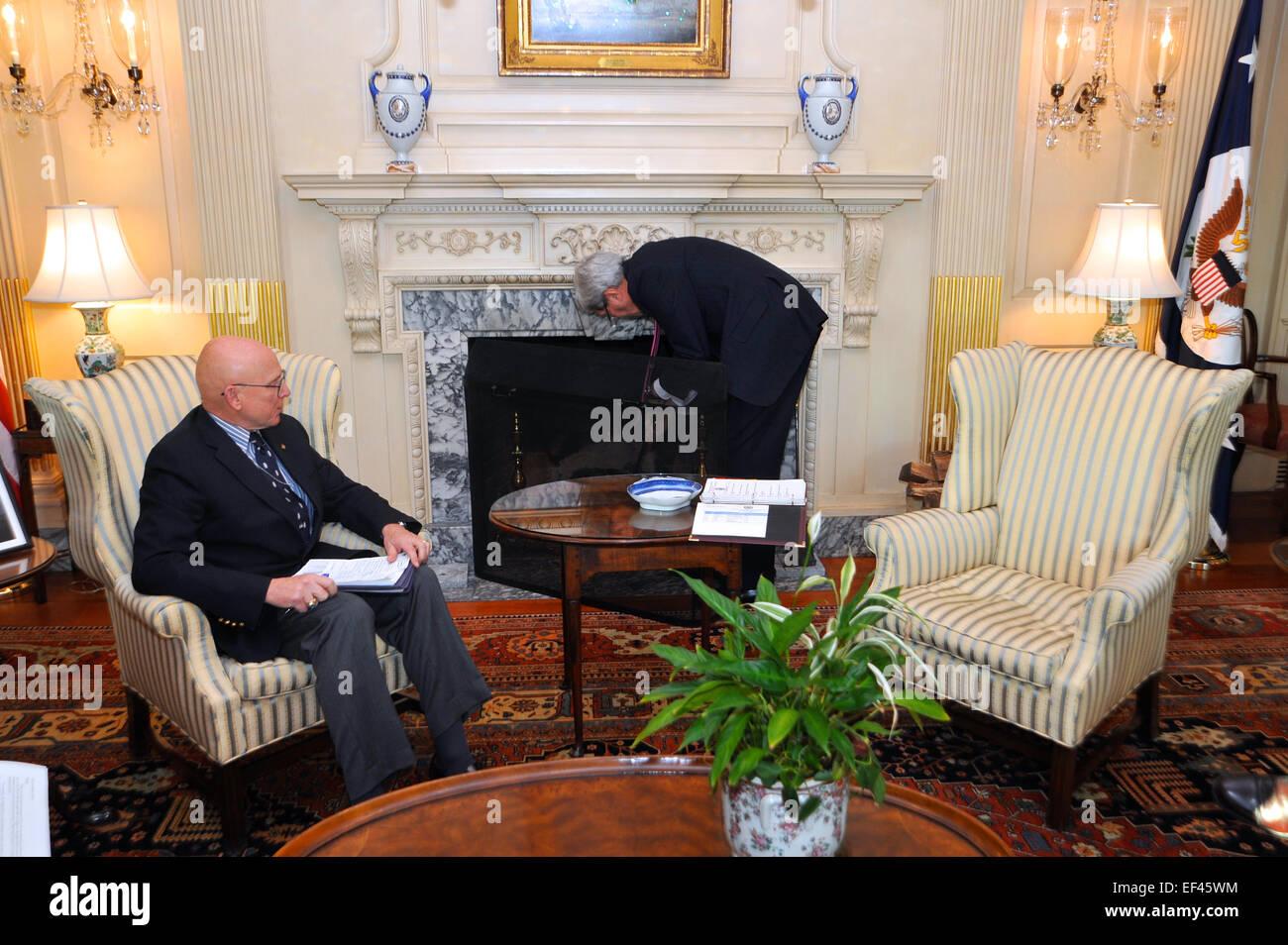 u s secretary of state john kerry stokes firewood in the