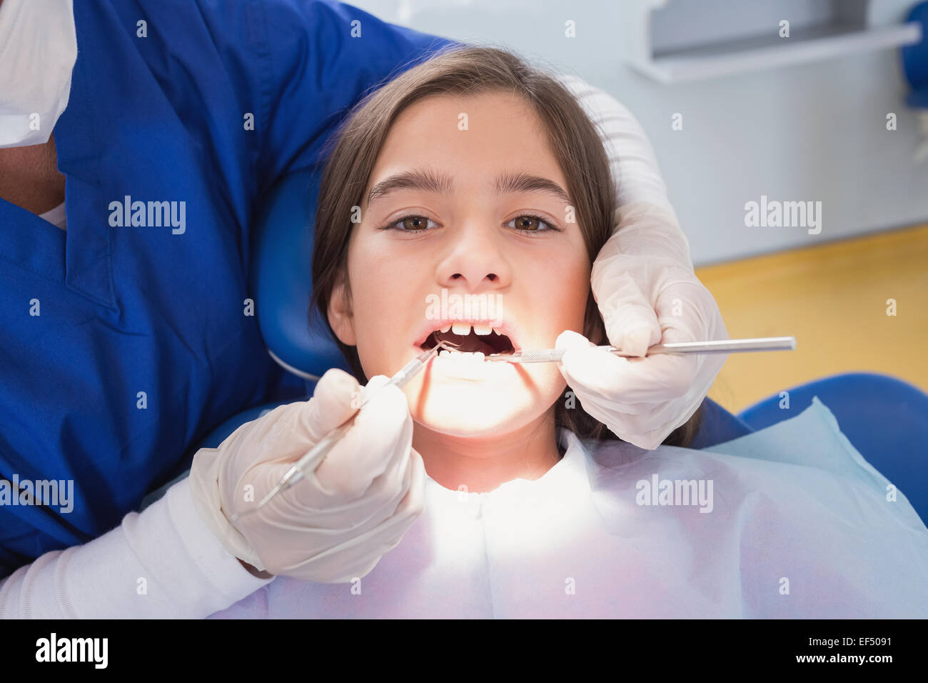 Scared Young Patient In Dental Examination
