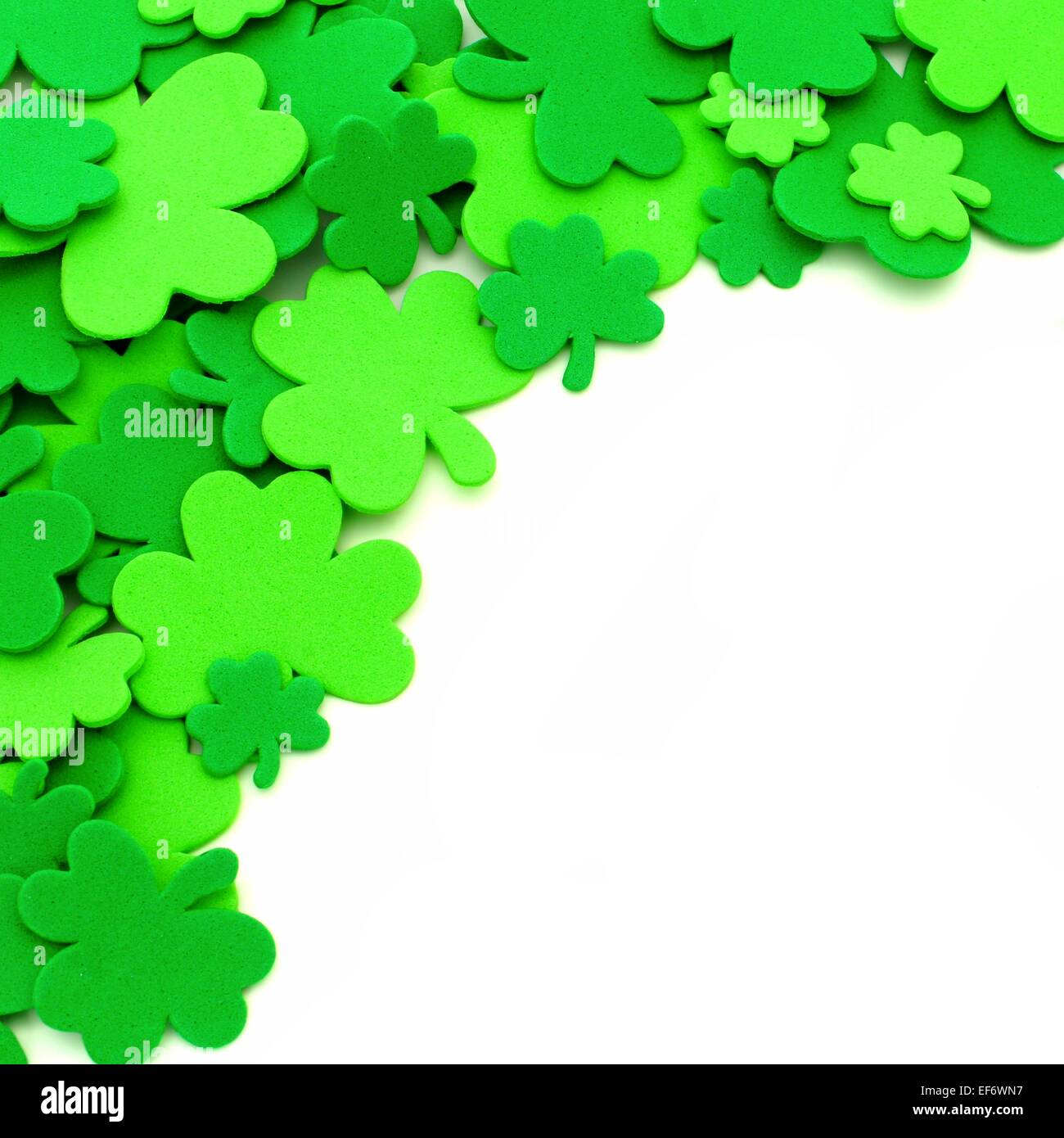 st patricks day shamrock corner border over a white background