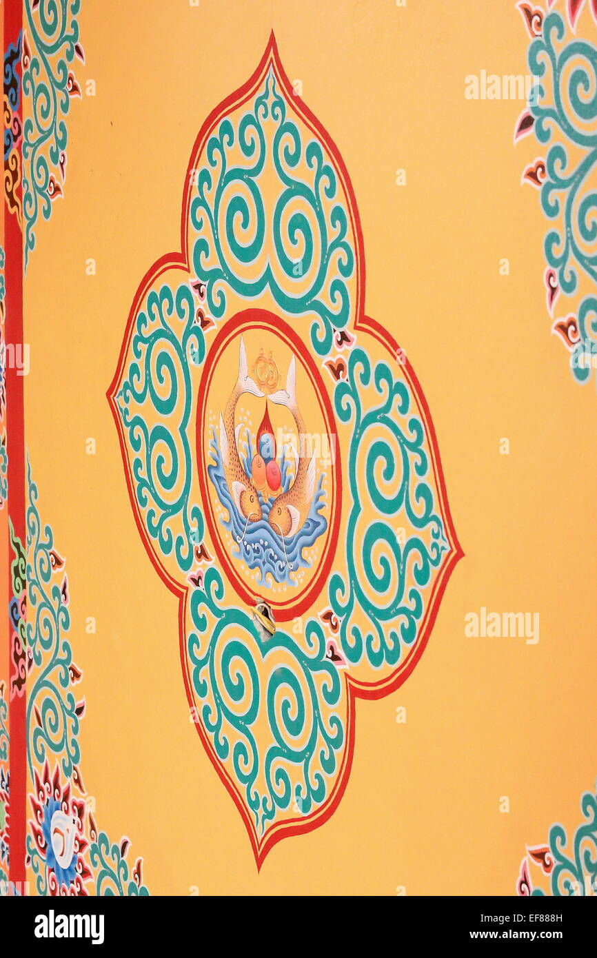 Buddhist drawing-decoration on tan color painted wall showing ...