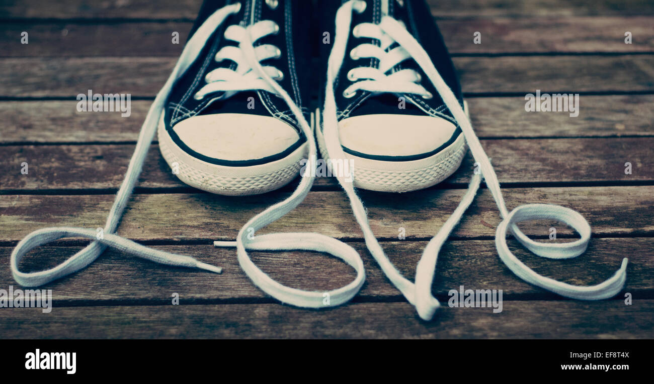 Canvas shoes and shoelaces spelling the word love stock photo canvas shoes and shoelaces spelling the word love publicscrutiny Images