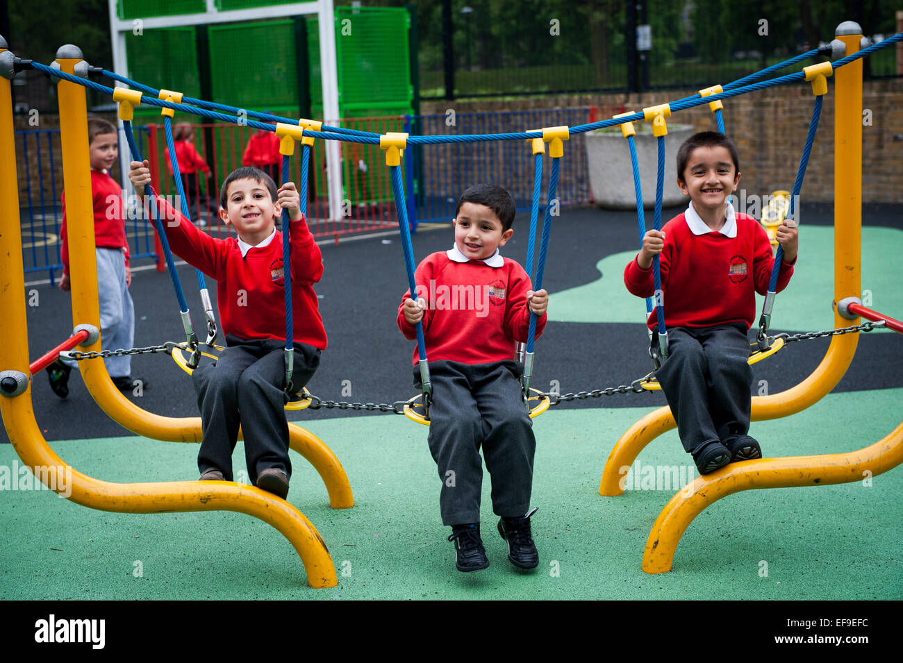 happy smiling children playing in the playground of primary school in london w2 - Images Of Children Playing At School