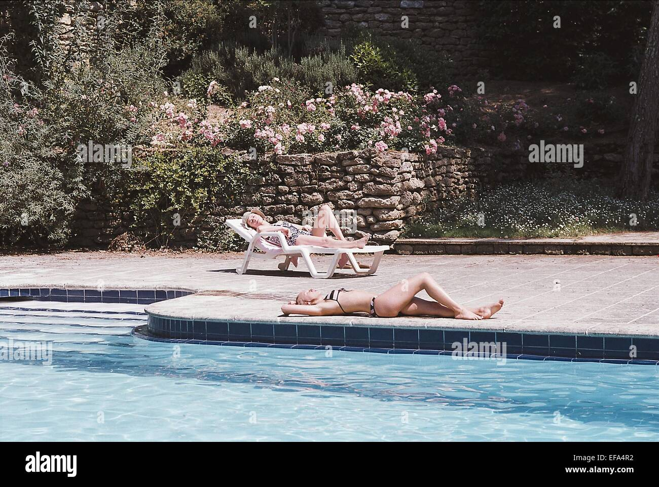 Charlotte rampling ludivine sagnier swimming pool 2003 stock photo royalty free image for Charlotte rampling the swimming pool