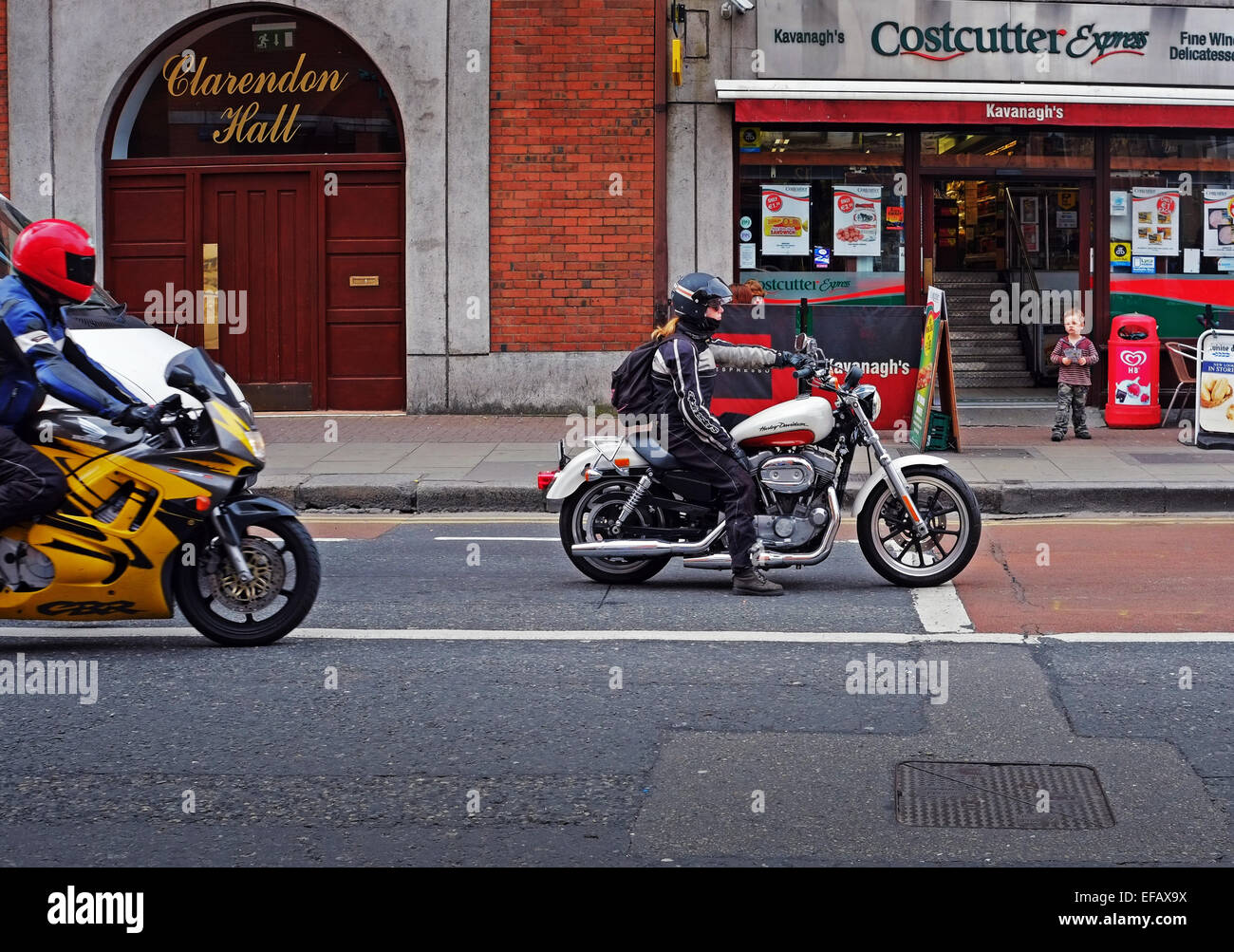 young woman riding a harley davidson motorcycle in dublin ireland