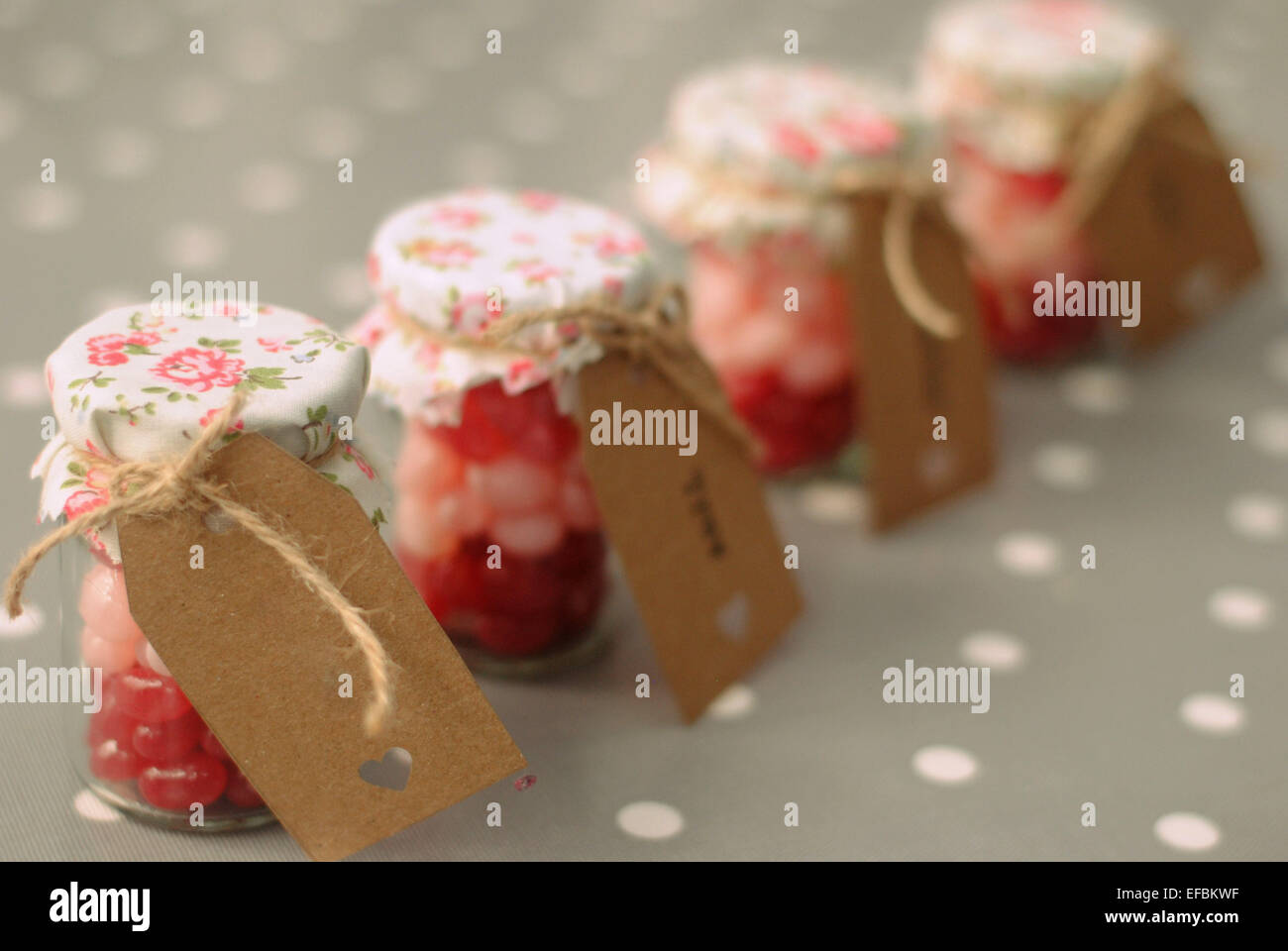 wedding favours tiny jam jars filled with stock