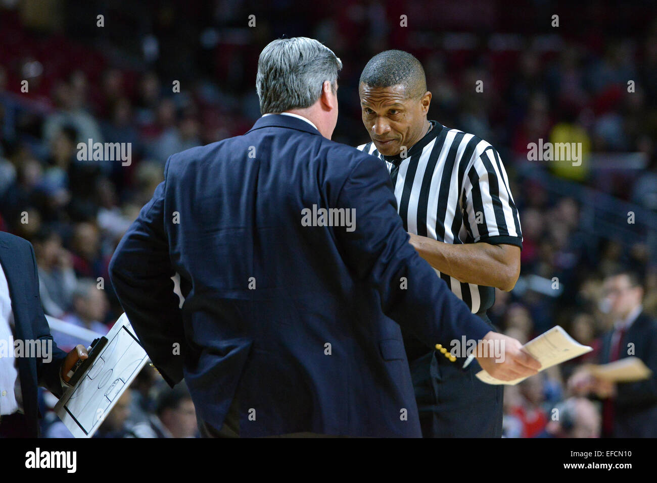 Ncaa Basketball Official Ted Valentine Listens To Tulane Green Wave Head  Coach Ed Conroy During The Aac Conference Basketball Game Being