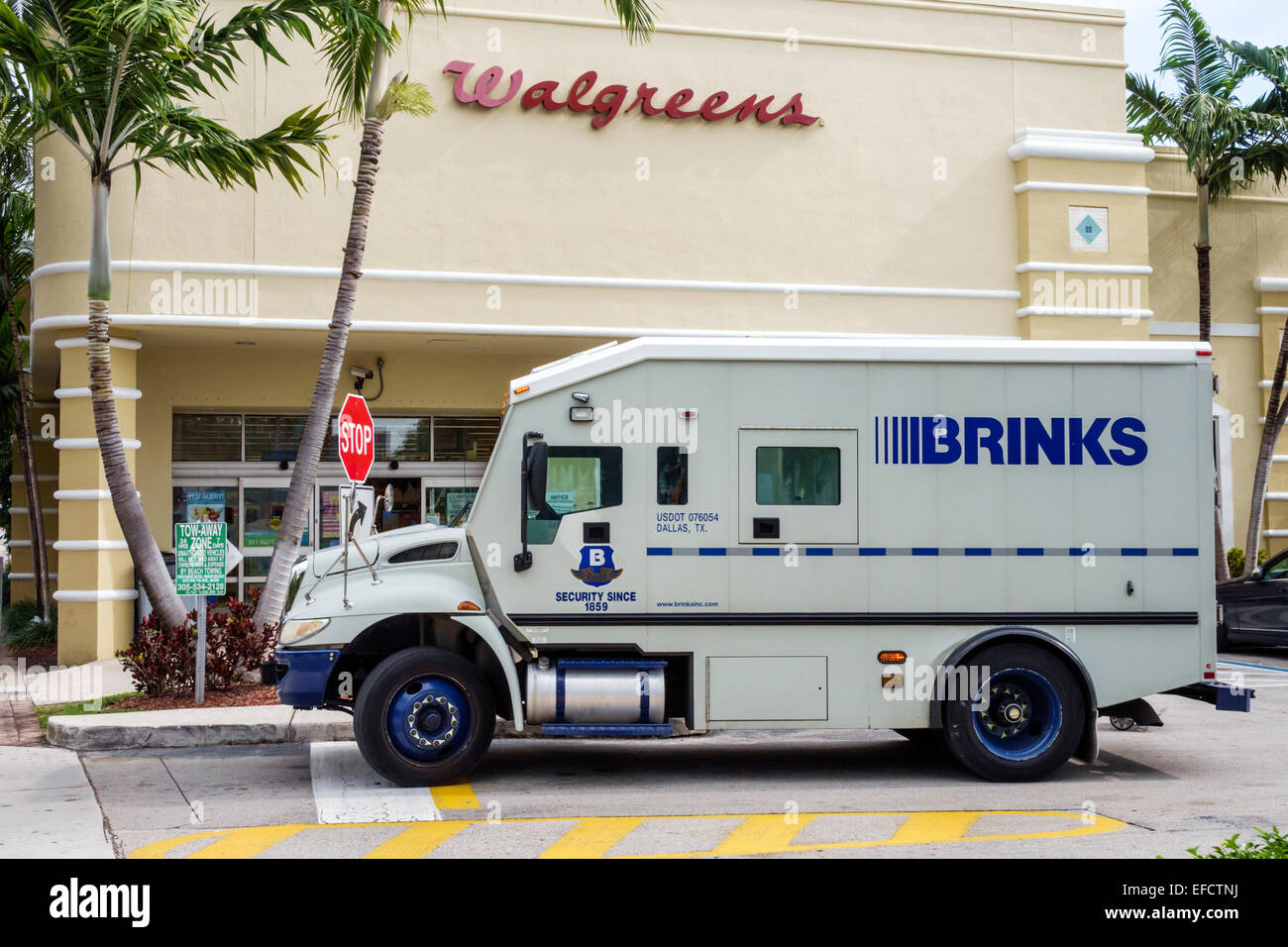 Brinks truck miami beach florida brinks armored truck security money parked walgreens drugstore pharmacy front stock photo