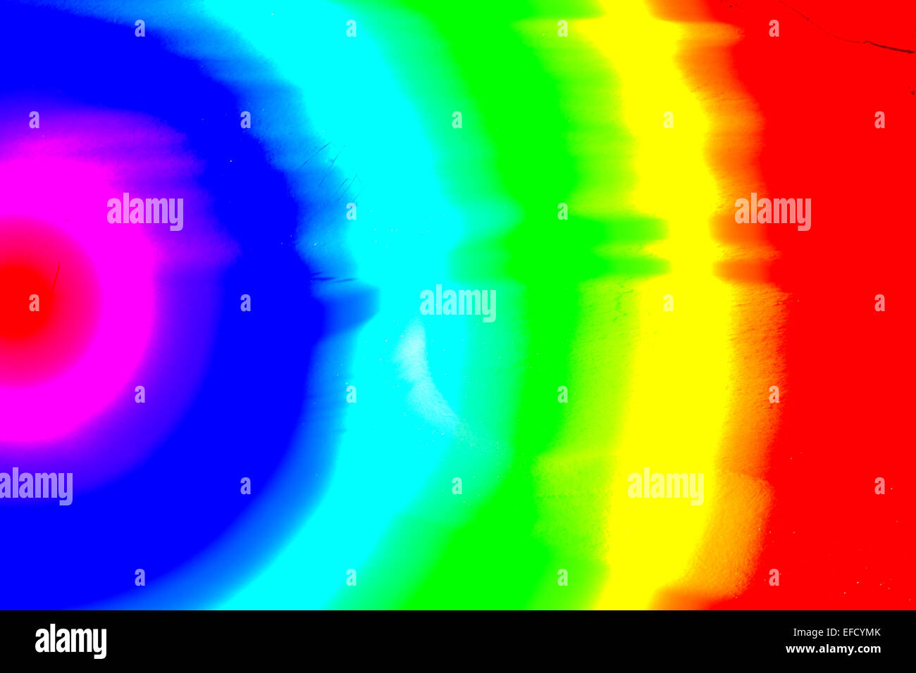a weird sun,with moving color waves,having a unique color display,drawing  the eye in.the movement of sound , movement of light