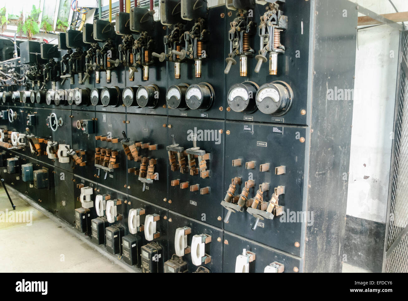very old electrical switchgear with gauges and edison