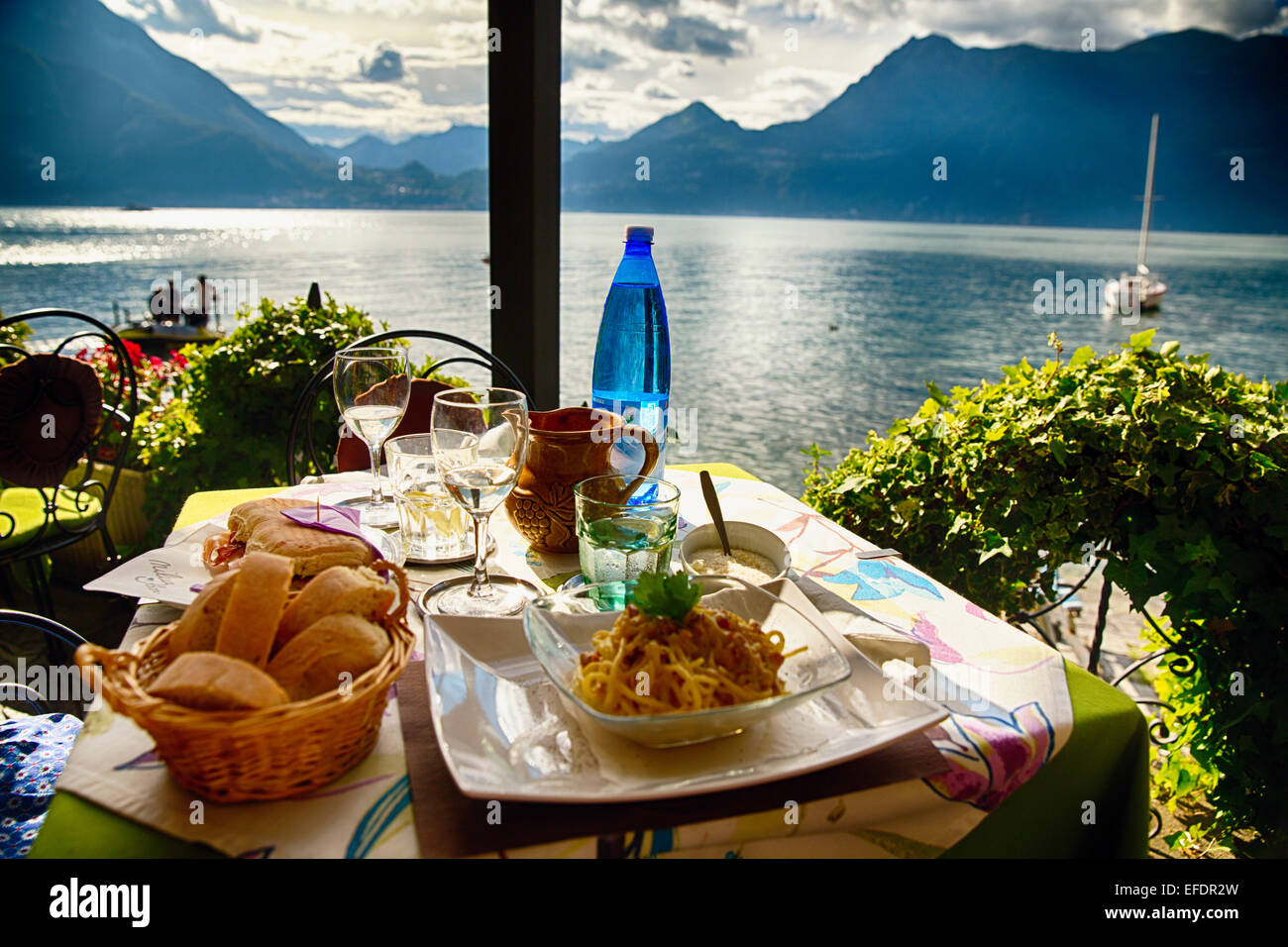 Food on a restaurant table with a lake view varenna lake for Varenna cuisine