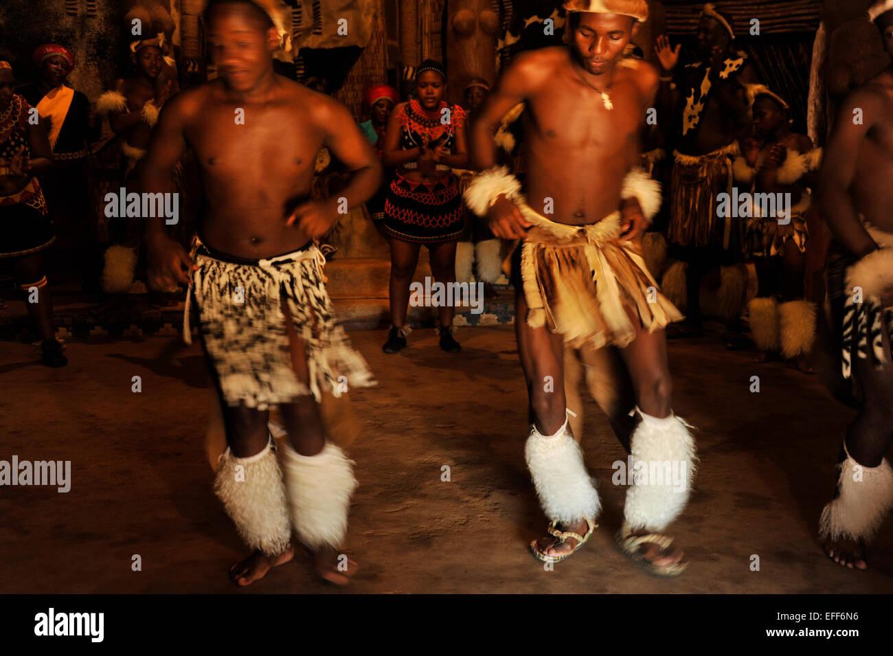 Zulu traditional dress in zulu kraal kwazulu natal - Two Male Traditional Zulu Dancers In Ceremonial Costume Entertaining Tourists At Shakaland Kwazulu Natal South
