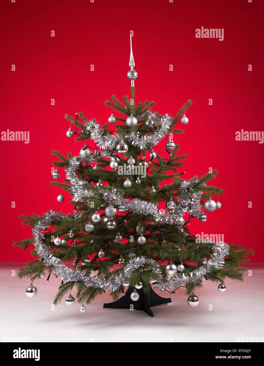 Decorated Christmas Tree With Silver Balls On Red