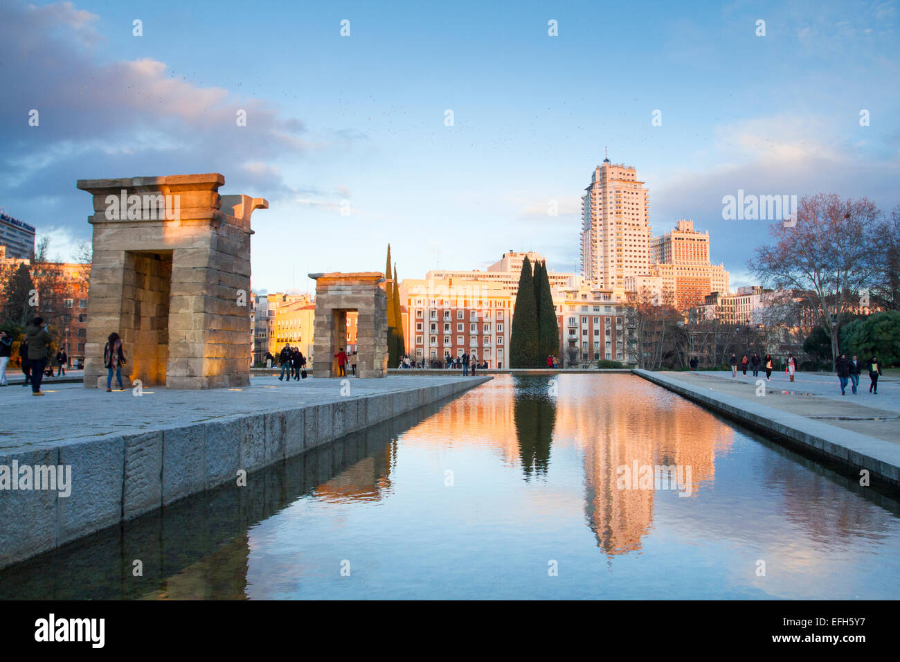 stock photo sunset in templo de debod with madrid tower known as torre de madrid and spain building edificio espaa at the back