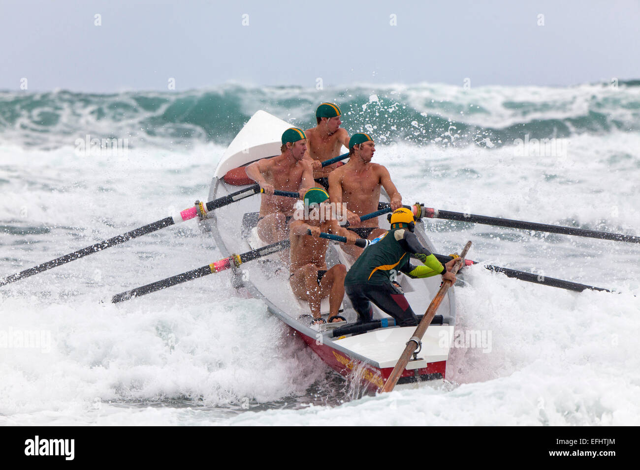 Lifesavers rowing through rough sea, Surf boat competition ...