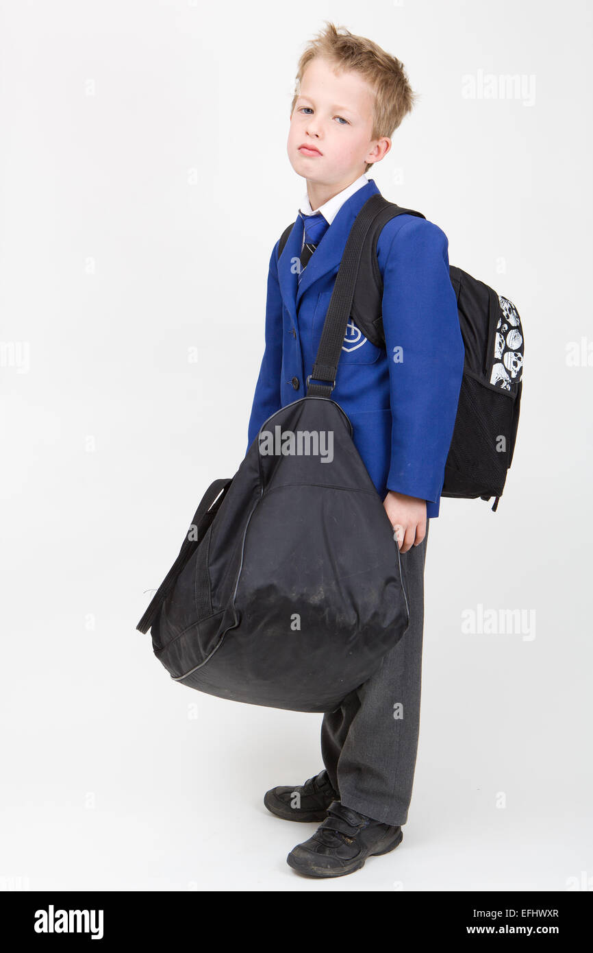 School bag for year 7 - 7 Year Old Boy In School Uniform Looking Unhappy With Heavy School Bags