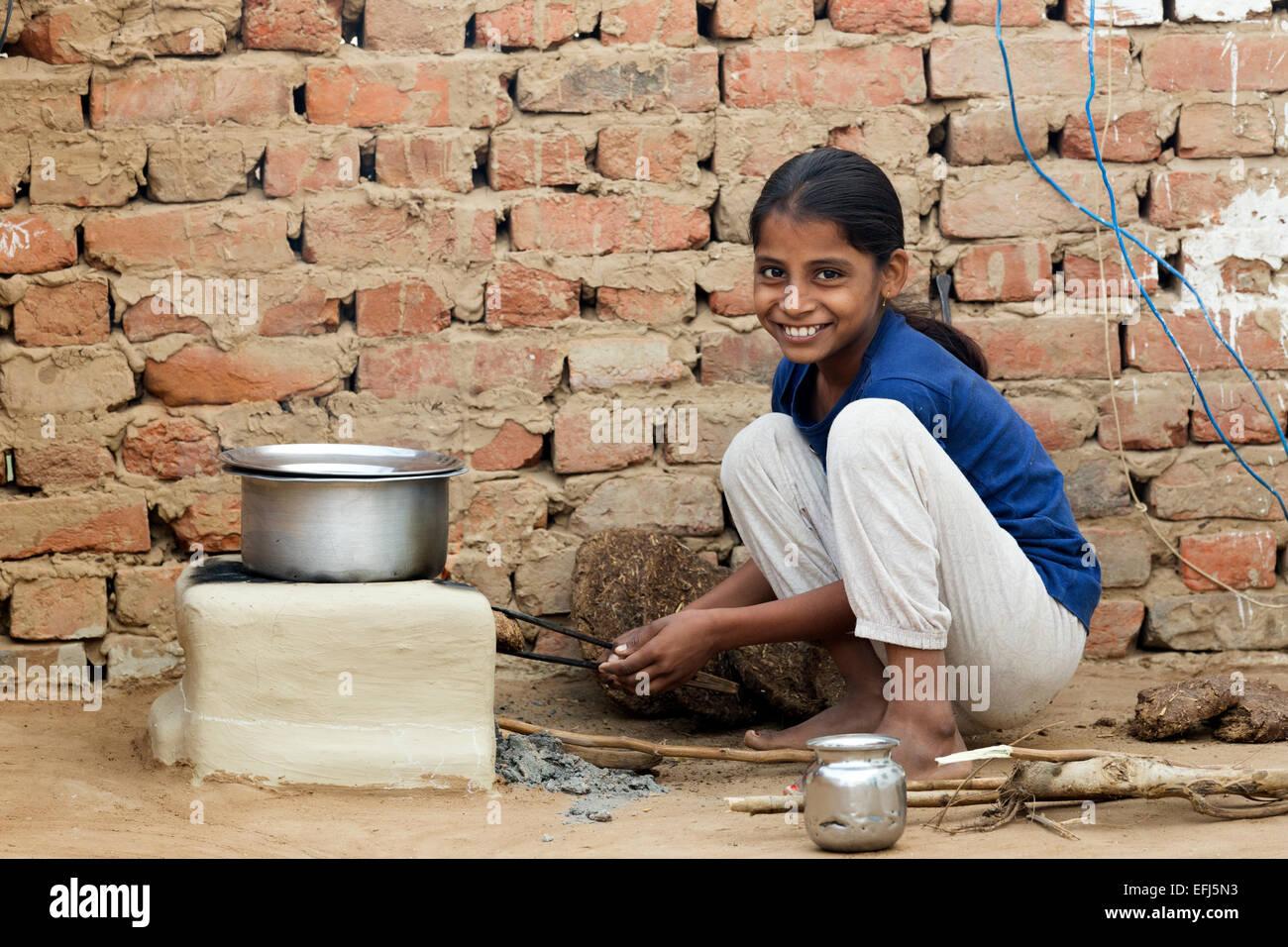 India uttar pradesh agra indian girl tending to outdoor for Cuisines of uttar pradesh