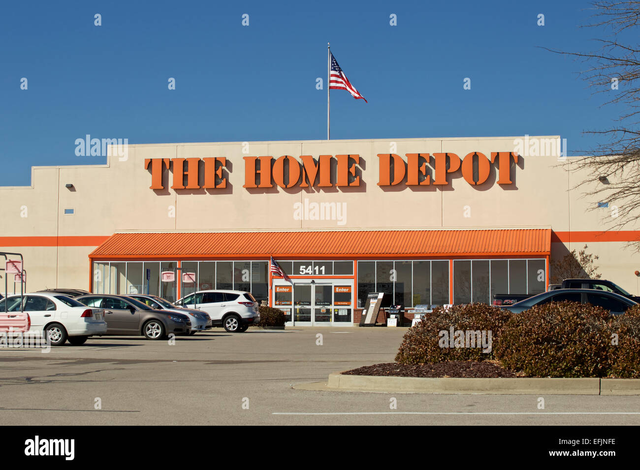 Home Depot Store Front And Parking Lot With American Flag