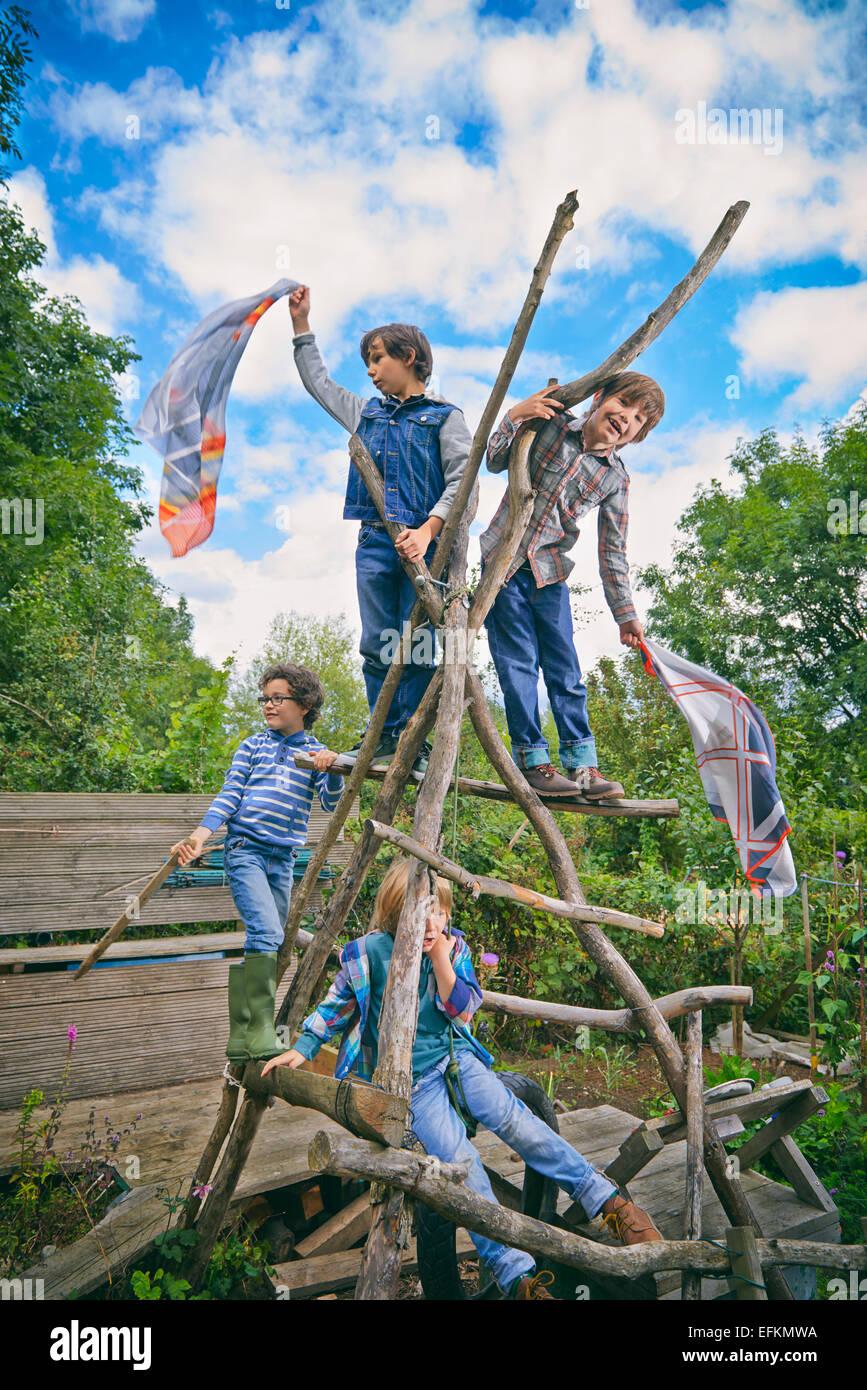 Homemade garden art - Four Boys Climbing On Homemade Climbing Frame In Garden