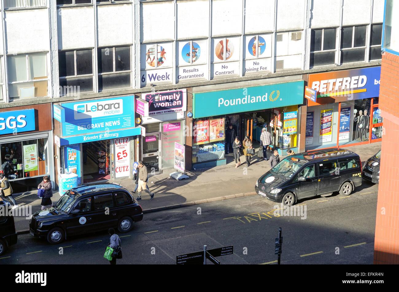 White apron poundland - Poundland Leicester City Center Uk Stock Image