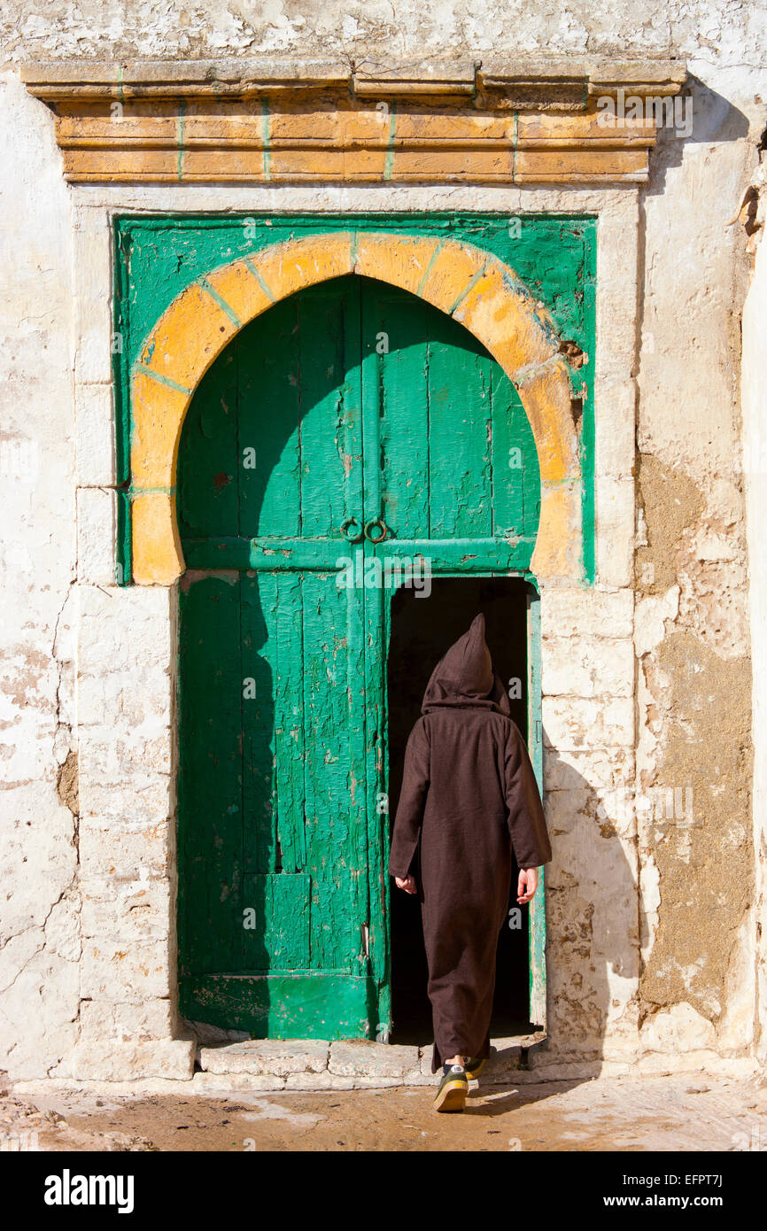 Rear view of man wearing traditional clothing stepping into door Essaouira Morocco & Rear view of man wearing traditional clothing stepping into door ... pezcame.com
