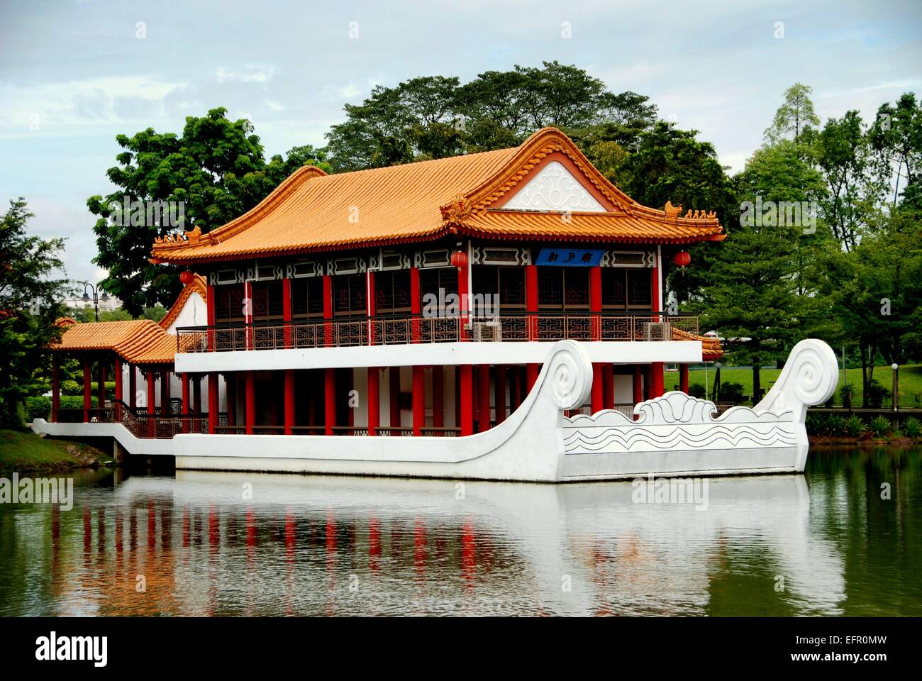 singapore a white marble boat with two story pavilion buit atop