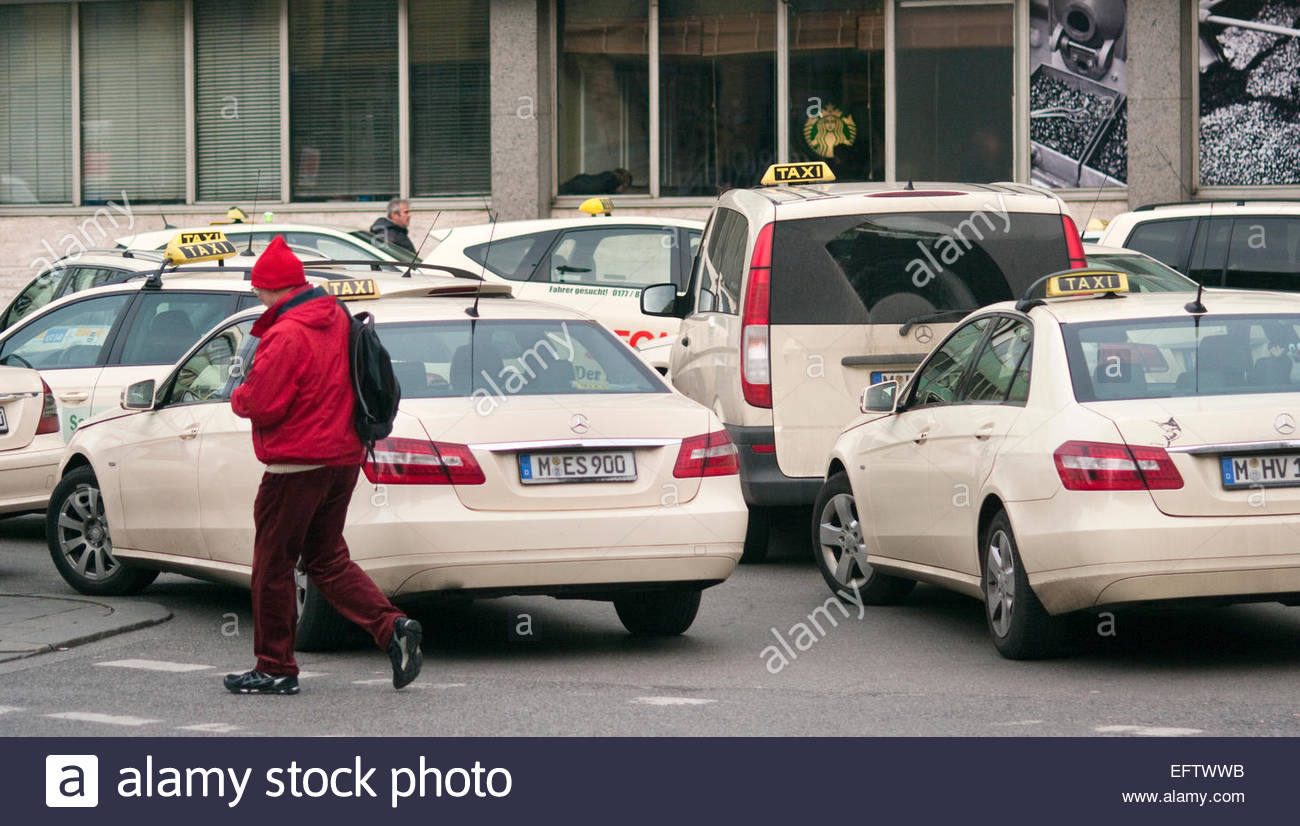 taxi rank outside main train station man walking wearing red munich stock photo royalty free. Black Bedroom Furniture Sets. Home Design Ideas